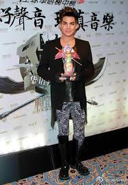 Adam Lambert displays his most recent award; Favorite International Artist.
